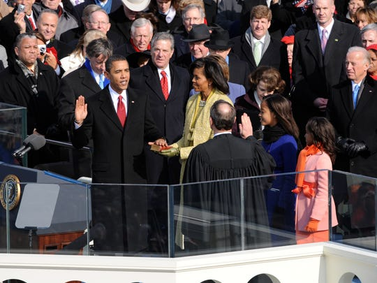 President Obama takes a botched oath of office from Supreme Court Chief Justice John Roberts in 2009. The two repeated the ceremony the following day inside the White House.