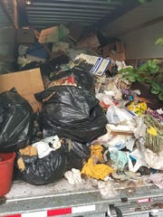 Police caught three people on July 16, 2018 dumping trash from a U-Haul truck on Detroit's east side.