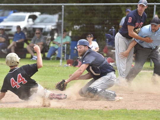 In a late 2017 game, Sister Bay catcher James Larsen tags out Kolberg runner Logan Jeanquart.