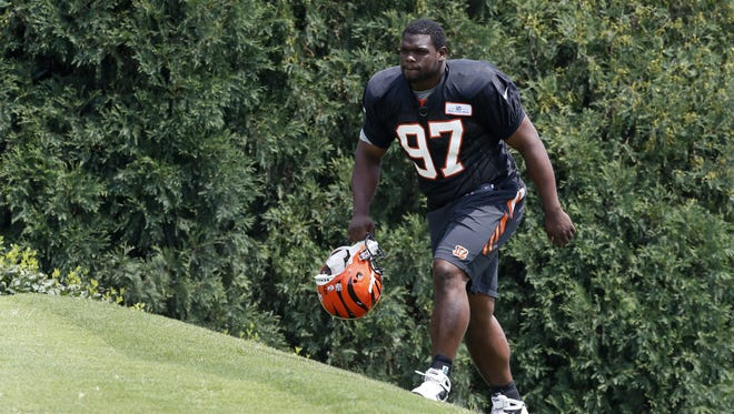 Cincinnati Bengals Defensive Tackle Geno Atkins walks on to the practice field for the first time during during training camp downtown.