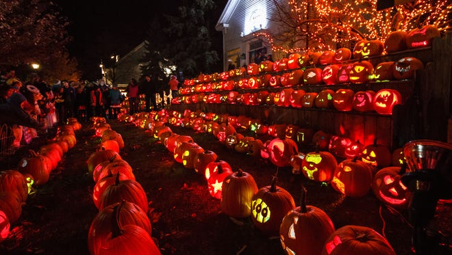 Spectators look on during the annual Halloween in Delafield Grand Pumpkin Illumination last year. This year's event is set for Saturday, Oct. 28.