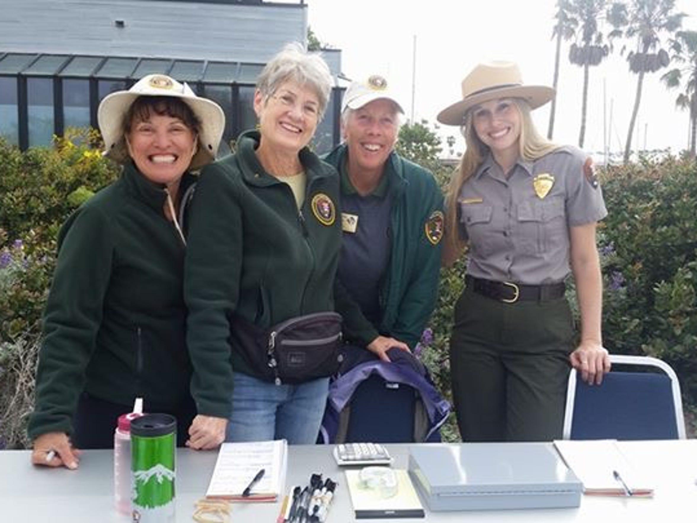 Ranger Lauren Boross, far right, is shown with park volunteers.