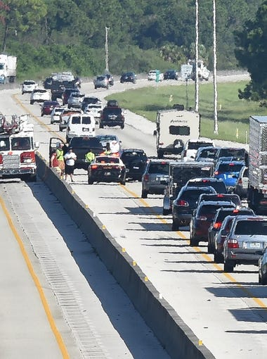 Traffic was backed up looking north along the Florida Turnpike Thursday morning from the Becker Road overpass.
