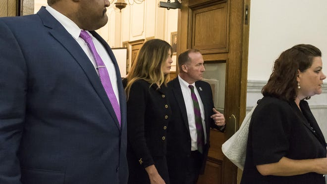 Pennsylvania Attorney General Kathleen Kane, second from left, is resigner her post after a jury convicted her late Monday of nine counts, including two felony perjury counts.