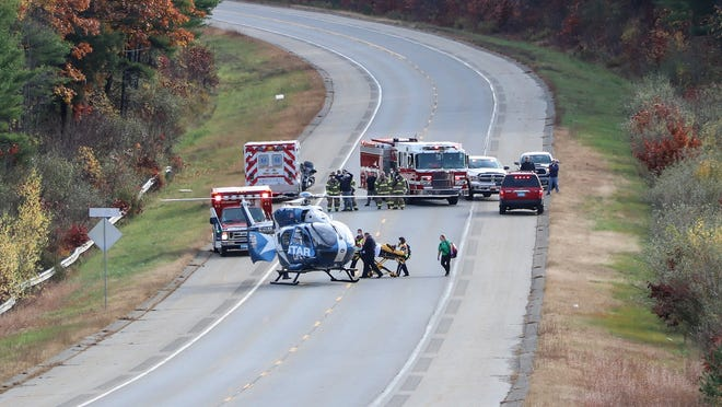 EAST BROOKFIELD - Emergency crews load a person into a medical helicopter on Route 49 after a tree reportedly fell on a front-end loader at an address on Podunk Road around 2:30 p.m. Sunday. Route 49 was closed between Adams Road and Flagg Road to land the Life Star helicopter.