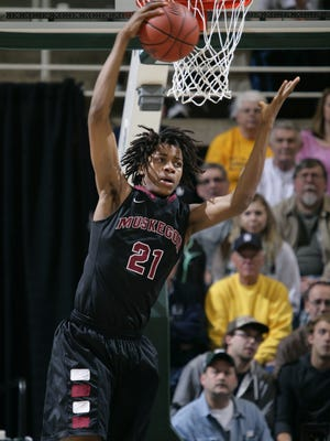 Muskegon's Deyonta Davis (21) grabs the ball after blocking a shot by Mt. Pleasant during their MHSAA Class A semifinal game Friday, March 21, 2014, in East Lansing, Mich.