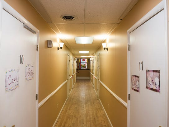 A hallway on the second floor of Harmony Personal Care