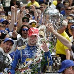 Andretti Autosports Alexander Rossi (98) celebrates after winning the 100th running of the Indianapolis 500 Sunday, May 29, 2016, afternoon at the Indianapolis Motor Speedway.