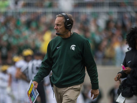 Michigan State Spartans head coach Mark Dantonio walks the sideline during the game against the Michigan Wolverines in East Lansing on Saturday, Oct. 29, 2016.