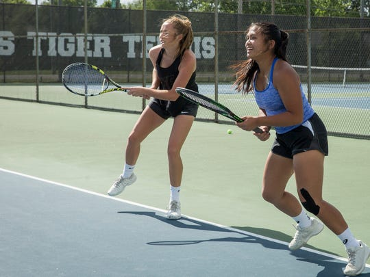 Yorktown's Samantha Academia practices with her doubles tennis partner Maddie Minniear on June 6 before going to state tennis this weekend.