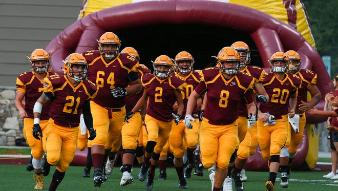 Cherokee football players take the field Friday for their game against Mitchell. The Mountaineers won, 21-0.