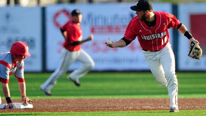 """UL second baseman Jace Conrad reacts after tagging out Western Kentucky outfielder Regan Flaherty (27) at second base on a steal attempt during the second inning of an NCAA baseball game at M.L. """"Tigue"""" Moore Field in Lafayette, LA, Saturday, March 29, 2014.   Paul Kieu, The Advertiser"""