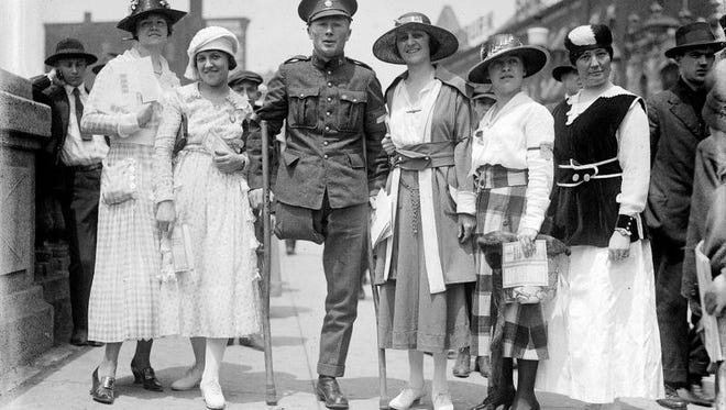Pvt. David I. Phillips, who lost a leg in the battle of Vimy Ridge in France during World War I, visited Rochester to help boost War Stamp sales. The women with him in this photo, believed to be from 1918, also were involved with the stamp drive. From left, they are: Winifred Andrews, Mary Hardle, Rose Hellenschmidt, Anna Goldman, and Tennessee Weller.