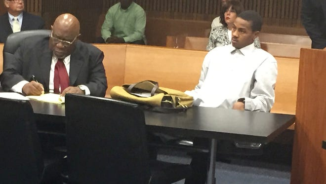 Attorney Otis Culpepper sits with former MSU basketball star Keith Appling as they appear in Wayne County Circuit Court on Aug. 31, 2016 for an emergency motion to reconsider bond requested by prosecutors.