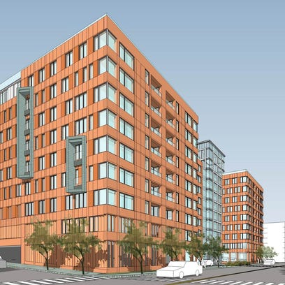 An artist rendering for an apartment building proposed