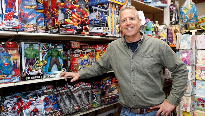 Greg Choron, owner of Merry-Go-Round toy store, is photographed in New Rochelle. The old-fashion toy store has been around for 65 years and carries all kinds of toys including bikes, videos games and educational toys.