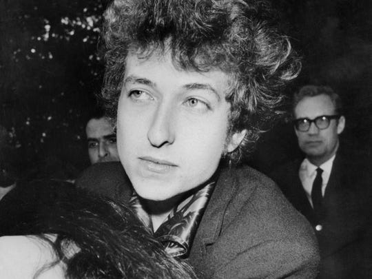 A crowd around Bob Dylan in March 1966 in New York.
