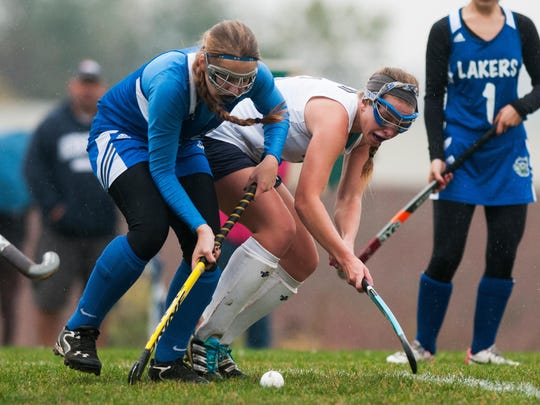 Colchester's Chloe Bullock (9) and MMU's Jordyn Gosselin (6) battle for the ball during the field hockey game between the Colchester Lakers and the Mount Mansfield Cougars at MMU High School on Tuesday afternoon October 21, 2014 in Jericho, Vermont. (BRIAN JENKINS, for the Free Press)