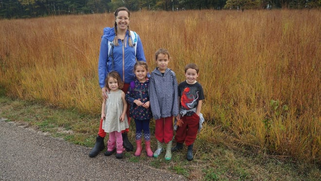 Amber Storm and her four kids on a hike at Lapham Peak