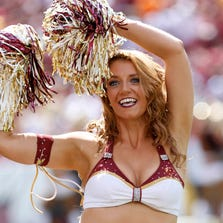 Sep 14, 2014; Landover, MD, USA; A Washington Redskins cheerleader dances on the field during a stoppage in play against the Jacksonville Jaguars at FedEx Field. The Redskins won 41-10. Mandatory Credit: Geoff Burke-USA TODAY Sports