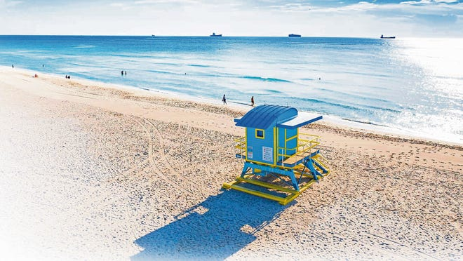 An iconic colorful lifeguard tower on Miami's South Beach.
