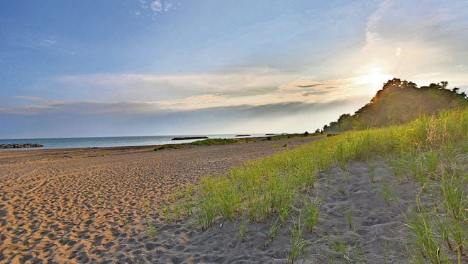 Presque Isle beach at sunrise.