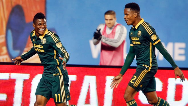 Portland Timbers' Dairon Asprilla (11), of Colombia, celebrates with teammate Alvas Powell (2), of Jamaica, right, after scoring against New York City FC during an MLS soccer game at Yankee Stadium, Sunday, April 19, 2015, in New York.