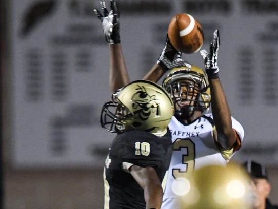 Gaffney senior Myell White(3) catches a pass for a