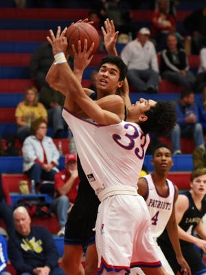 Cameron Brooks-Harris goes up for a shot in the lane during Zanesville's 61-45 loss against Wheeling Park. Brooks-Harris was named first-team All-Ohio on Tuesday by the Ohio Prep Sportswriters Association.
