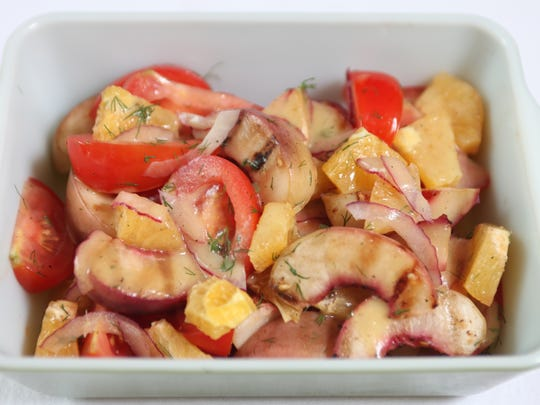 Chef Ninamarie Bojekian prepared this grilled peach salad as a picnic food, from her Franklin Lakes kitchen. Thursday July 11, 2013.