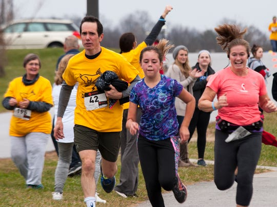 Runners enter the final stretch of the Tommy A. Bryson Memorial Deer Dash Saturday. Proceeds from the event will fund a new basketball court in Mills River in honor of Bryson.