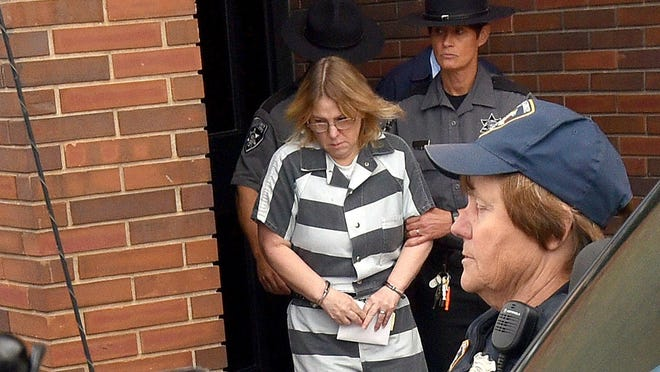 Joyce Mitchell leaves Clinton County Court after being sentenced, Monday, Sept. 28, 2015, in Plattsburgh, N.Y. Mitchell, who helped two convicted murderers escape from a maximum-security lockup by providing them with tools, was sentenced to up to seven years behind bars. (Rob Fountain/Press-Republican via AP) MANDATORY CREDIT