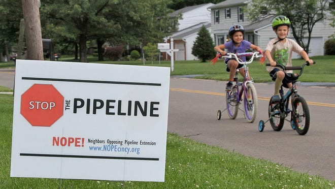Yard signs in Blue Ash and elsewhere display residents' opposition to a proposed Duke Energy high-pressure natural gas pipeline.