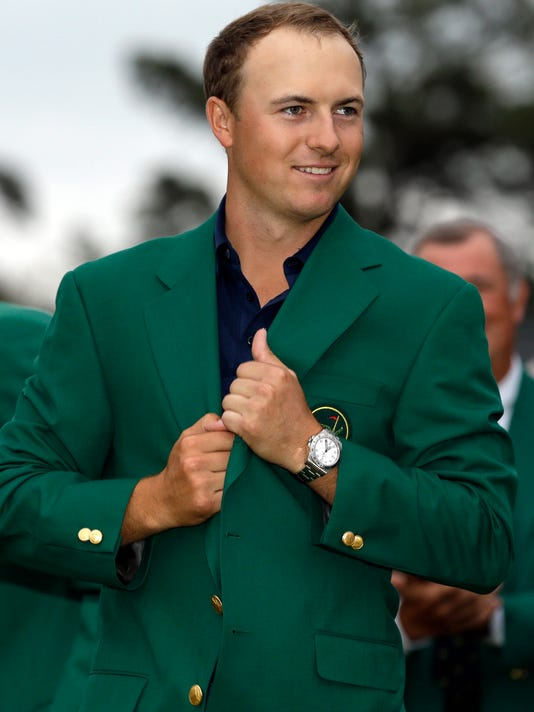 FILE - In this April 21, 2015, file photo, Jordan Spieth wears his green jacket after winning the Masters golf tournament in Augusta, Ga. Spieth says the jacket is too big for him because he still has the one given to him the day he won the Masters. (AP Photo/David J. Phillip, File)