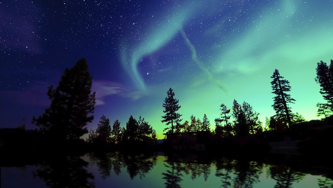 Federal forecasters said the Northern Lights may be able to be seen Tuesday night as far south as Iowa or Pennsylvania
