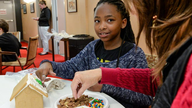 Volunteer mentor Beverly Elgin-Harris, right, of Anderson helps Tamara Finley, 10, of Anderson decorate a gingerbread house during the Big Brother Big Sisters of the Upstate event at the Anderson County Museum in Anderson on Tuesday.