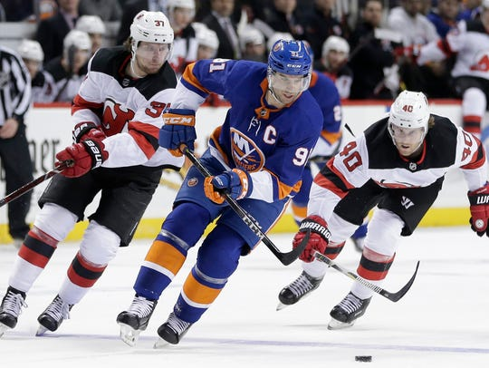 New York Islanders' John Tavares moves the puck downice