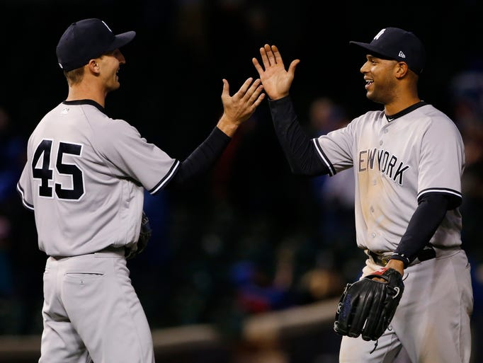 New York Yankees' Aaron Hicks, right, celebrates with