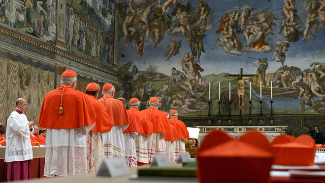 Cardinals queuing in the Sistine Chapel