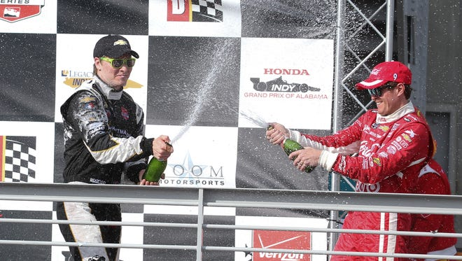 Apr 26, 2015; Birmingham, AL, USA; Indy Cart Series Josef Newgarden (67) and Indy Cart Series Scott Dixon (9) spray each other with champagne after Newgarden won the Grand Prix of Alabama at Barber Motorsports Park. Mandatory Credit: Marvin Gentry-USA TODAY Sports
