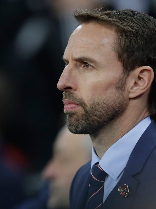 England's manager Gareth Southgate listens to the playing of the national anthem just prior to the start of the international friendly soccer match between England and Germany at Wembley stadium in London, Friday, Nov. 10, 2017. (AP Photo/Matt Dunham)