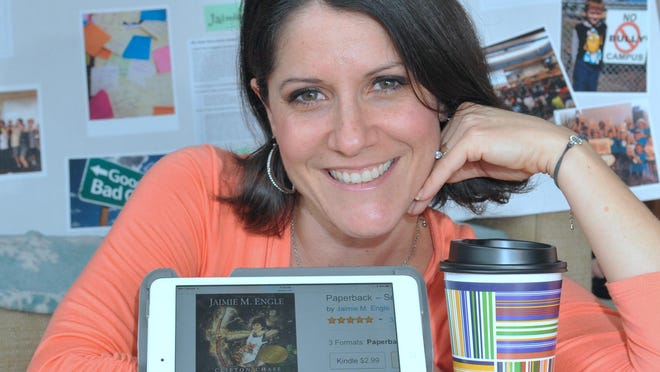 """Author Jaimie M. Engle at home. Her anti-bullying book """"Clifton Chase and the Arrow of Light"""" is now available on audiobook nationwide."""