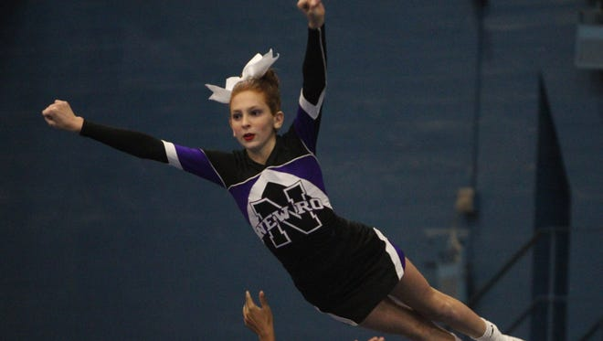 New Rochelle cheerleaders perform at the 65th Annual Westchester County Cheerleading Invitational at the Westchester County Center in White Plains on Nov. 26. The team won the Varsity II small division title.