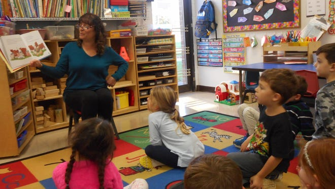 Karen Rostoker-Gruber reads her book Rooster Can't Cock-a-Doodle-Doo to the Kinder Plus class at The Preschool Place & Kindergarten.