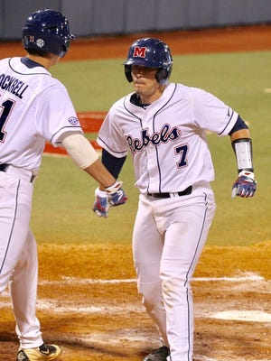Nick Fortes (7) singled to give Ole Miss an early lead against Auburn in the SEC Tournament Tuesday night.