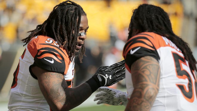 Cincinnati Bengals outside linebacker Vontaze Burfict, left, and middle linebacker Rey Maualuga shake hands during warm ups before the first quarter of the Bengals game in Pittsburgh on Sunday.