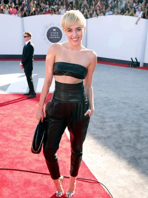 Miley Cyrus arrives at the MTV Video Music Awards at The Forum on Sunday, Aug. 24, 2014, in Inglewood, Calif.