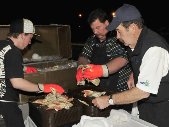 From left, Clay Stover, Mike Stover and Harry Peck prepared more than 1,600 pounds of king crab before the Tulare Rotary Club Annual Crab Feed in 2011.