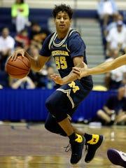 Spring Grove High School graduate Eli Brooks is averaging 2.2 points per game this season for Michigan. AP FILE PHOTO
