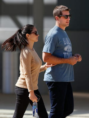 Green Bay's quarterback Aaron Rodgers and actress Olivia Munn walk to the set of a commercial filmed in downtown Appleton in September.